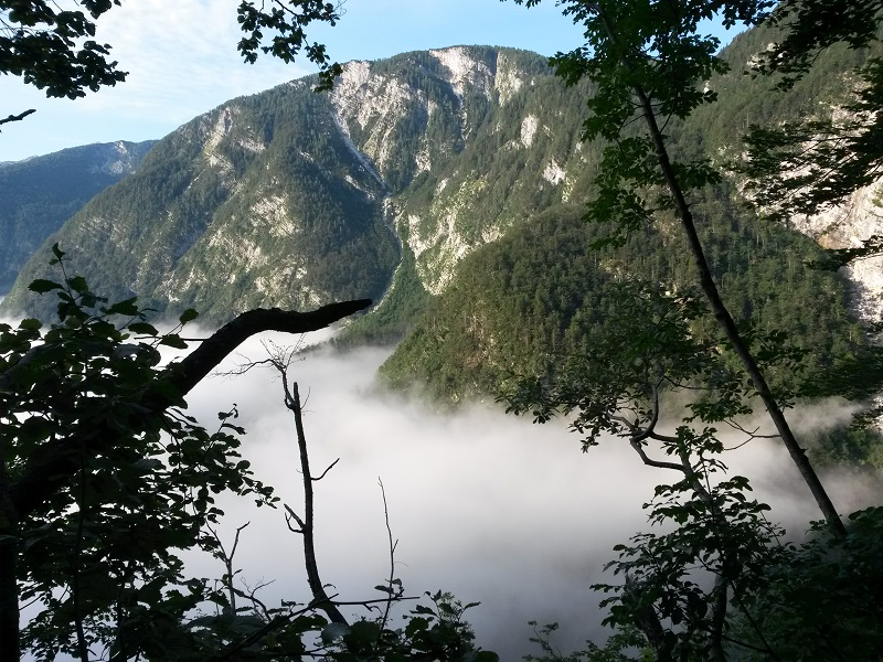 foggy Bohinj valley from Komarča cliff, hiking Slovenian mountains