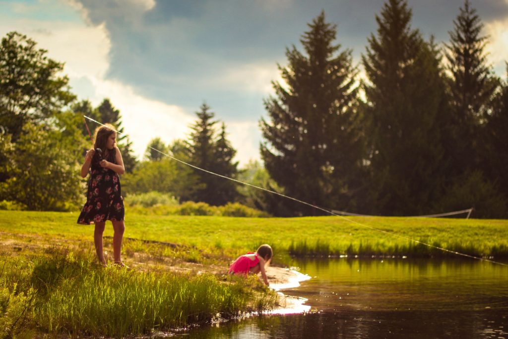kids fishing in pond